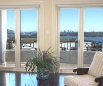 Панорамные распашные двери на балкон