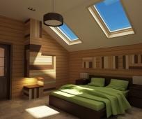 Обшивка мансардной спальни деревянной вагонкой коричневых оттенков
